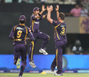 Gautam Gambhir and Jacques Kallis celebrate the wicket of S Badrinath