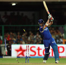 Shaun Tait's off stump goes flying courtesy RP Singh, Royal Challengers Bangalore v Rajasthan Royals, IPL 2013, Bangalore, April 20, 2013