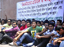 Cricketers sit outside the Shere Bangla National Stadium, protesting the delay in holding the Dhaka Premier League