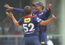 Roelof van der Merwe and Mahela Jayawardene celebrate a wicket