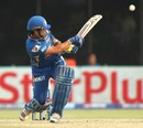 Sachin Tendulkar hits the ball towards fine leg