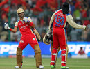 Virat Kohli and Chris Gayle celebrate in signature fashion