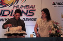 Sachin Tendulkar cuts a cake on his 40th birthday, as his wife Anjali looks on