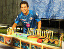 Sachin Tendulkar has a look at his 40-pound birthday cake