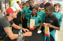 Kevin Pietersen signs autographs