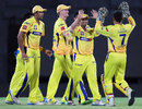 Suresh Raina is congratulated after effecting a run out