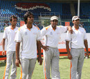 Wasim Akram leans on Mohammad Akram during the fast bowling camp, National Academy, Karachi, April 26, 2013