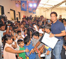 Sachin Tendulkar interacts with kids at a promotional event