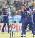 James Faulkner celebrates with Rahul Dravid