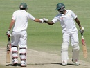 Elton Chigumbura and Graeme Cremer punch gloves, Zimbabwe v Bangladesh, 2nd Test, Harare, 3rd day, April 27, 2013