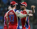 Virat Kohli and AB de Villiers celebrate a run-out