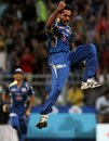 A jubilant Dhawal Kulkarni leaps in celebration, Mumbai Indians v Royal Challengers Bangalore, IPL, Mumbai, April 27, 2013