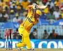 Suresh Raina drives down the ground