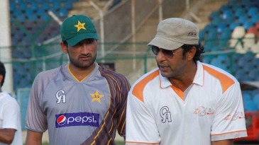 Wasim Akram and Sohail Tanvir at a camp in Karachi