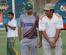 Wasim Akram and Sohail Tanvir at a camp in Karachi, April 28, 2013