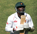 Shingi Masakadza walks back after being dismissed for 24