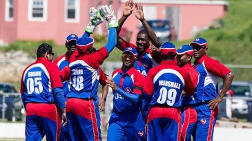 The USA team celebrate a wicket