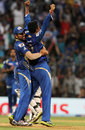 Pragyan Ojha and Rohit Sharma celebrate David Hussey's wicket, Mumbai Indians v Kings XI Punjab, IPL 2013, Mumbai, April 29, 2013