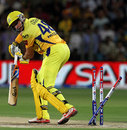 Michael Hussey is bowled through the gate