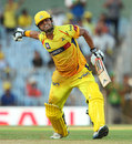 Suresh Raina exults after scoring his first IPL century