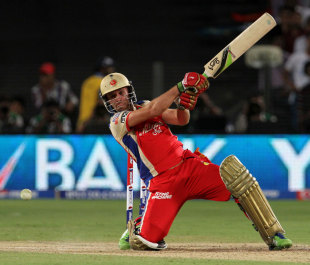 AB de Villiers launches the ball through the off side, Pune Warriors v Royal Challengers Bangalore, IPL 2013, Pune, May 2, 2013