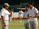 Wasim Akram talks to fast bowlers at a camp in Karachi, April 28, 2013