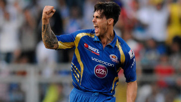 Mitchell Johnson celebrates a wicket