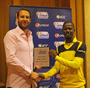 Uganda captain Davis Arinaitwe collects his Player of the Series award, Nepal v Uganda, World Cricket League Division 3, final, Hamilton, May 5, 2013