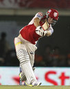 David Miller hits a shot during his unbeaten hundred, Kings XI Punjab v Royal Challengers Bangalore, IPL 2013, Mohali, May 6, 2013