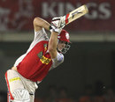 David Miller plays a powerful drive during his hundred, Kings XI Punjab v Royal Challengers Bangalore, IPL 2013, Mohali, May 6, 2013