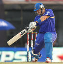 Shane Watson hits through the off side