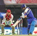 Ajinkya Rahane plays an inside-out shot over mid off