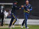 Chris Rushworth gets a high five from Paul Collingwood