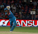 Robin Uthappa drives the ball down the ground, Pune Warriors v Kolkata Knight Riders, IPL 2013, Pune, May 9, 2013