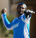 Tamim Iqbal tosses a ball during a practice session