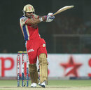 Virat Kohli stands tall and plays a pull shot