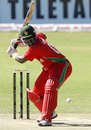 Hamilton Masakadza winds up to hit the ball
