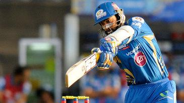 Dinesh Karthik hits through the off side