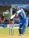 Dinesh Karthik hits through the off side, Pune Warriors v Mumbai Indians, IPL, Pune, May 11, 2013