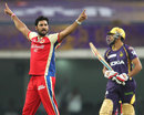 Ravi Rampaul celebrates the wicket of Manvinder Bisla