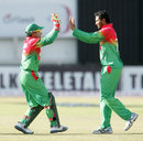 Mushfiqur Rahim and Shakib Al Hasan celebrate the fall of a wicket