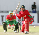 Brendan Taylor plays a sweep shot during his innings of 15