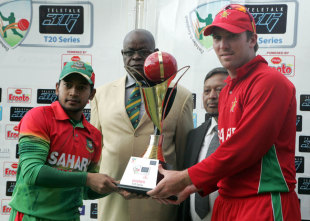 Mushfiqur Rahim and Brendan Taylor with the trophy after Bangladesh leveled the series with a 34-run win in the second T20