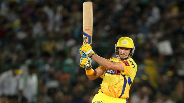 Michael Hussey smacks a ball through the on side