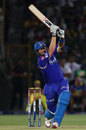 Shane Watson hoists the ball over the legside