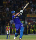 Shane Watson powers a ball during his innings
