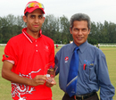 Waqas Khan receives his Man of the Match award from Match Referee Tan Kim Hing after scoring 60* and claiming 4-32 against Bahrain at the ACC Under-19 Elite 2013 in Kuala Lumpur on 10th May 2013