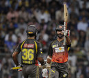 Shikhar Dhawan raises his bat after scoring a half-century, Mumbai Indians v Sunrisers Hyderabad, IPL 2013, Mumbai, May 13, 2013