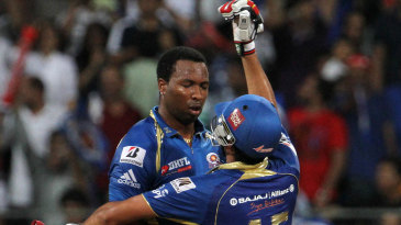Rohit Sharma and Kieron Pollard celebrate after winning the match