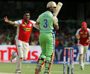 Parvinder Awana celebrates after taking Cheteshwar Pujara's wicket, Royal Challengers Bangalore v Kings XI Punjab, IPL 2013, Bangalore, May 14, 2013